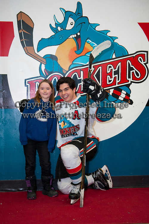 KELOWNA, CANADA - FEBRUARY 10: Nick Merkley #10 of the Kelowna Rockets poses with a young fan outside the dressing room after on-ice warm up against the Vancouver Giants on February 10, 2017 at Prospera Place in Kelowna, British Columbia, Canada.  (Photo by Marissa Baecker/Shoot the Breeze)  *** Local Caption ***