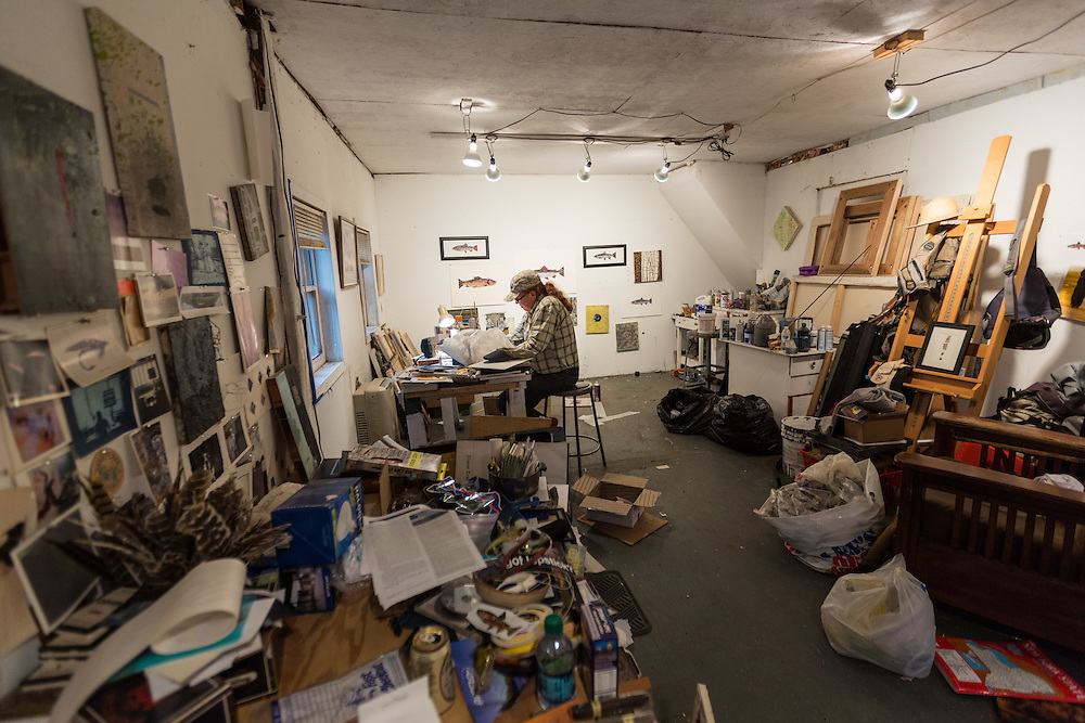 Fly fishing guide, artist and Patagonia Ambassador, Rachel Finn at work in her art studio in Wilmington, New York