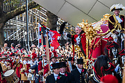 The Mayor in his golden carriage - The new Lord Mayor (Peter Estlin, the 691st) was sworn in yesterday. To celebrate, today is the annual Lord Mayor's Show. It includes Military bands, vintage buses, Dhol drummers, a combine harvester and a giant nodding dog in the three-mile-long procession. It brings together over 7,000 people, 200 horses and 140 motor and steam-driven vehicles in an event that dates back to the 13th century. The Lord Mayor of the City of London rides in the gold State Coach.