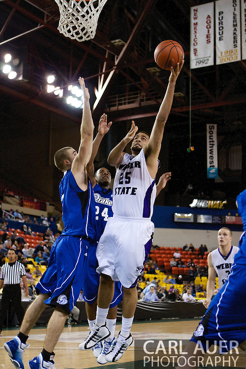November 27th, 2010:  Anchorage, Alaska - Weber State freshman forward Byron Fulton (25) floats a shot up in the Weber State 82-81 victory over the Drake Bulldogs in the third place game of the Great Alaska Shootout.
