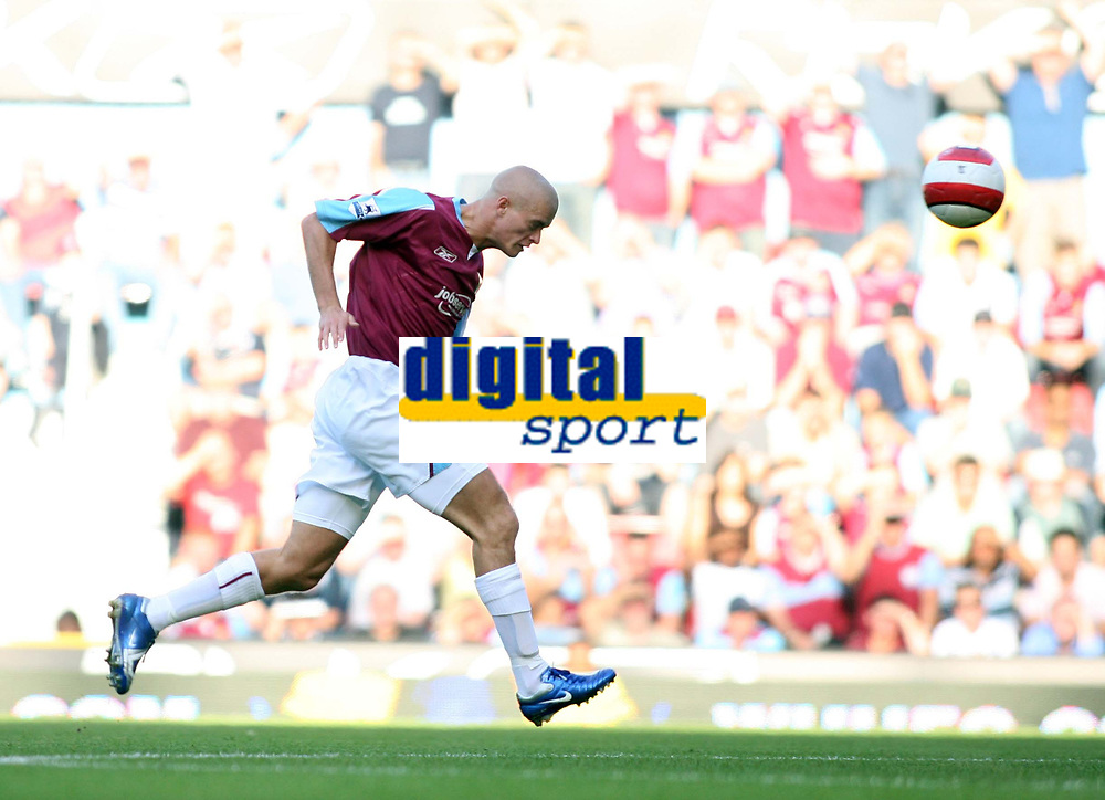 Photo: Chris Ratcliffe.<br /> West Ham United v Aston Villa. The Barclays Premiership. 10/09/2006.<br /> Paul Konchesky of West Ham heads the ball into the box from which Bobby Zamora scores the first goal.