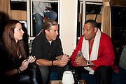 Holly Coates, guest, and Laurence Fishburne