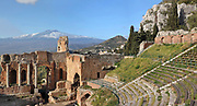 Greek Theatre, built 3rd century BC, seating 5400, in Taormina, Messina, Sicily, Italy. In the distance is Mt Etna. Although originally and typically Greek, used for theatre and music performances, the theatre was remodelled in the 2nd century AD by the Romans and used for games and gladiatorial contests. Picture by Manuel Cohen