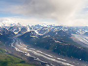 Aerial view of Denali (Mt. McKinley; far left), the Tokositna Glacier (lower left), the Ruth Glacier (right) and the Alaska Range on a sightseeing flight from Talkeetna, Alaska.