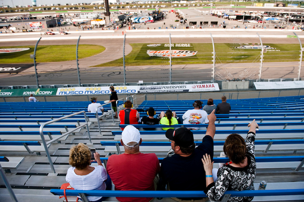NEWTON, IOWA. -AUG. 1, 2014: Fans cheer on NASCAR drivers as they prepare for the NASCAR Nationwide Series auto race at Iowa Speedway Friday, Aug. 1, 2014. Lauren Justice for The New York Times