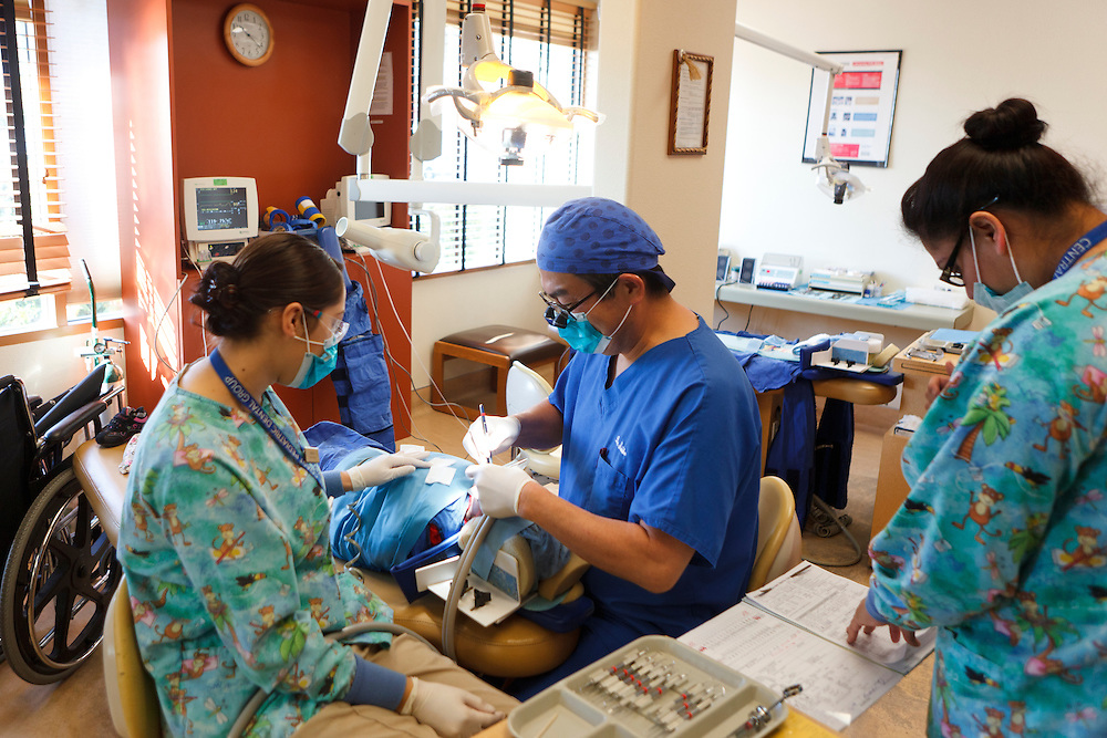Kenji Saisho, M.D., D.D.S., treats a patient Tuesday, Dec. 13, 2011, at Central Coast Pediatric Dental Group in Salinas, California.
