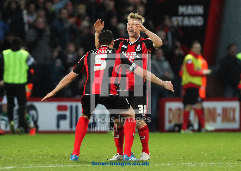 Picture by Tom Smith/Focus Images Ltd 07545141164<br /> 26/12/2013<br /> Matt Ritchie (back centre) of Bournemouth runs over to Tommy Elphick (front centre)of Bournemouth in celebration of scoring the goal to make it 2-0 to his side during the Sky Bet Championship match at the Goldsands Stadium, Bournemouth.
