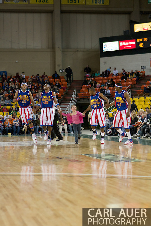 April 30th, 2010 - Anchorage, Alaska:  Time out on the floor as the Harlem Globetrotters borrow a young fan from the croud to play with on the floor of the Sullivan Arena.