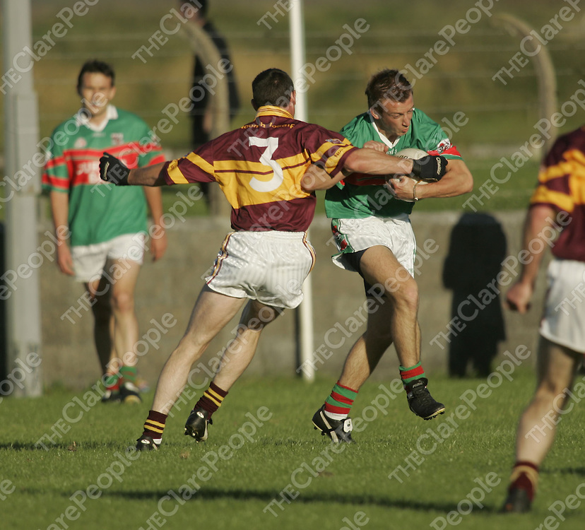 St Josephs Miltown's Enda Malone and Kilmurry Ibrickane's Peter O'Dwyer in action during their Clare Senior Football Championship Game played in Doonbeg Co. Clare.<br />