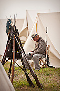 Confederate re-enactor reads in camp during events at Fort Moultrie Charleston, SC. The re-enactors are part of the 150th commemoration of the US Civil War.