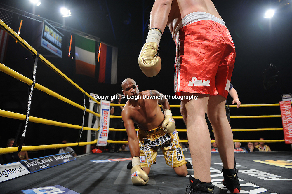 Evgeny Orlov knocks down Gregory Tony in Quarter Final 2 at Prizefighter International on Saturday 7th May 2011. Prizefighter / Matchroom. Photo credit © Leigh Dawney. Alexandra Palace, London.