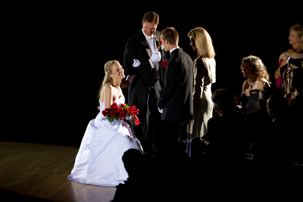 Caption:(Wednesday 12/28/2011 St. Petersburg)(L-R) Katie Elizabeth Fredrickson, presented by her father, Michael J. Fredrickson, bows to her escort, Adam Michael Bennett and her mother, Lisa Fredrickson. The Presentation Ball, hosted by the St. Petersburg Debutante Club began in 1937. The event was held at The Colisuem in St. Petesburg on Wednesday Dec. 28, 2011...Summary:The Presentation Ball, hosted by the St. Petersburg Debutante Club. ..Photo by James Branaman
