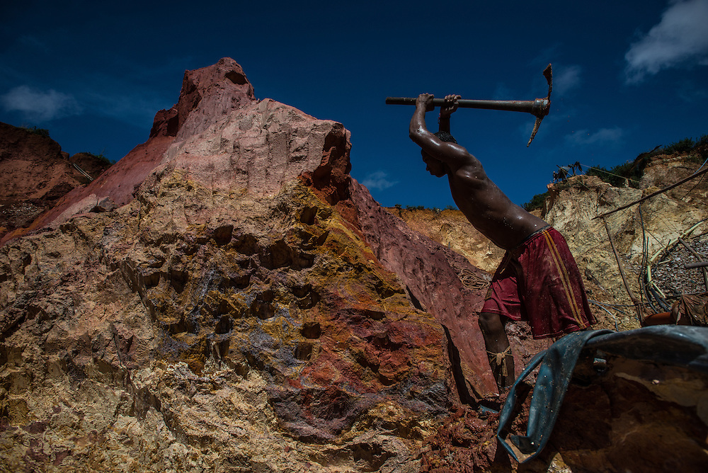 "LAS CLARITAS, VENEZUELA - JULY 20, 2016:  Carlos Freydel, 26, mines for gold at ""Cuatro Muertos"" mine outside of Las Claritas.  Freydel said he has fallen ill with malaria 60 times during the 9 years he has worked illegally mining for gold. When he gets malaria, it usually keeps him from being able to work in the mine for a full week.  Even though he has suffered so much from malaria, ""it is worth it, because there is money here,"" he said.  He mistakingly thinks that he gets malaria from the water, and did not believe visiting journalists that said he gets it from being bit by mosquitos.  Thousands of Venezuelans are flocking to illegal gold mines, like this one, in hopes of surviving the current economic crisis by earning in gold instead of the national currency, whose value steadily falls due to the world's highest inflation.  From this remote part of the jungle the migrant miners have become the vectors of a new epidemic of malaria, because the hot, swampy conditions of the mines make for an ideal breeding ground for mosquitos. Miners spread the disease as they return home with earnings or pay visits to family members. The economic crisis has also left the government without the financial resources to control the disease - they are unable to fumigate homes, provide medicines to everyone that is sick, or even to test all patients with symptoms of malaria in many places. PHOTO: Meridith Kohut"