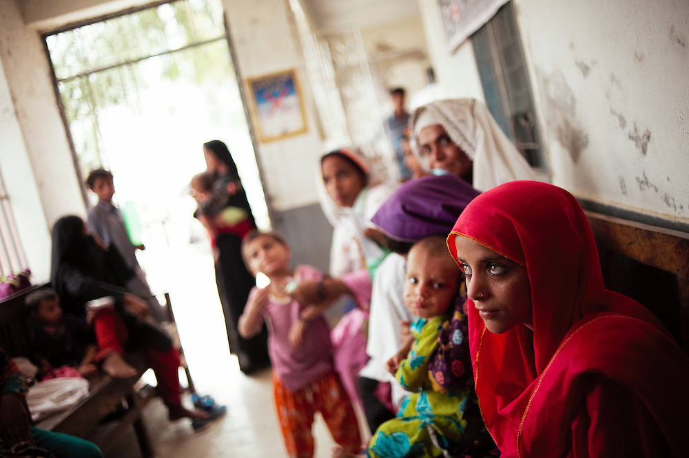 A girl waits for her mother in the government health clinic, Barrat Khan Lagar, Dadu, Sindh, Pakistan on July 5, 2011.