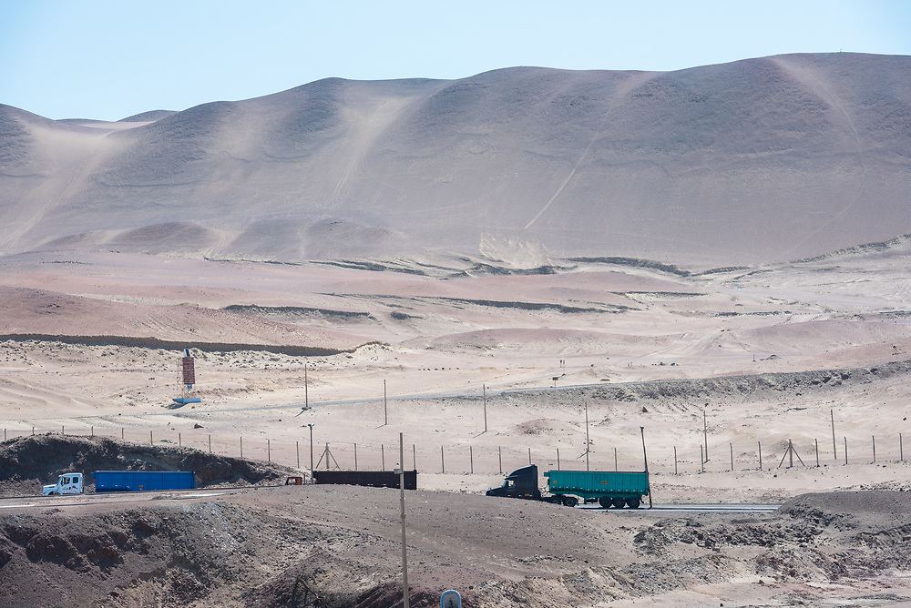 Paracas, Peru -- April 11, 2018. Three trucks are driving on a road through the desert in Paracas, Peru. Editorial use only.
