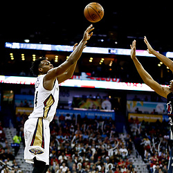 Dec 28, 2016; New Orleans, LA, USA;  New Orleans Pelicans guard Buddy Hield (24) shoots over Los Angeles Clippers forward Wesley Johnson (33) during the second half of a game at the Smoothie King Center. The Pelicans defeated the Clippers 102-98. Mandatory Credit: Derick E. Hingle-USA TODAY Sports