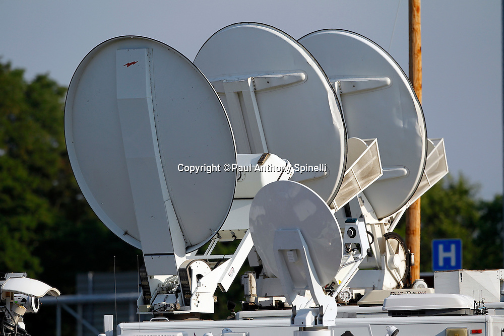 Television broadcast dishes stand ready to televise the game prior to the NFL Pro Football Hall of Fame preseason football game between the Dallas Cowboys and the Cincinnati Bengals on Sunday, August 8, 2010 in Canton, Ohio. The Cowboys won the game 16-7. (©Paul Anthony Spinelli)