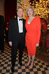 The Home Secretary THERESA MAY MP and her husband PHILIP MAY at the Sugarplum Dinner - The event was for the launch of Sugarplum Children, a new website and fundraising initiative for children who live with type 1 diabetes, and to raise money for JDRF (Juvenile Diabetes Research Foundation) held at One Mayfair, 13A North Audley Street, London on 20th November 2013.