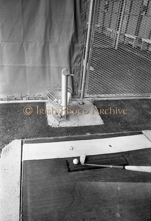 14/05/1965<br /> 05/14/1965<br /> 14 May 1965<br /> New Golf Range at Leopardstown, Foxrock, Dublin. Image shows a ball dispenser or placer, in on of the cubicles on the driving range.