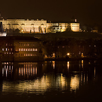 Prague Castle with reflections on the Vltava River, taken from the Charles Bridge.