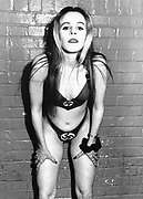Woman in Swastika Underwear at Submission, club, London, 1990s.