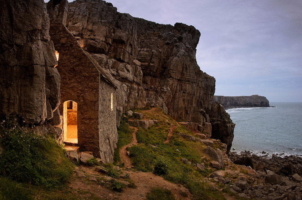 Evening falls on St. Govan's Chapel nestled into the cliffs of Pembrokeshire, Wales.  This chapel speaks to the hardship Celtic Saints endured as the spread out from Ireland into Wales.
