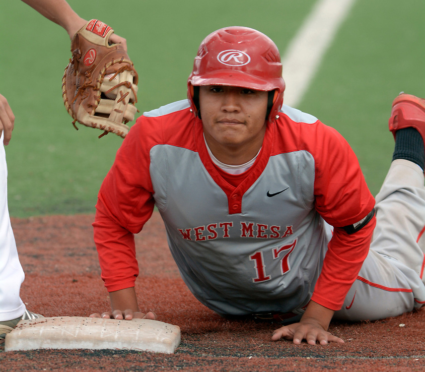 gbs042517k/SPORTS -- West Mesa's Chirs Aspaas is safe after he dove back to first base during the game at Valley on Tuesday, April 25, 2017.  (Greg Sorber/Albuquerque Journal)