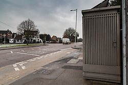 A grey metal toilet sits just across the green from the village pub, The Crown & Crooked Billet, at the turn-around point of bus routes in Chigwell, Essex. It has divided opinion among local residents, some of who object to its presence whilst others believe it is essential for the bus drivers. Chigwell, Essex, January 24 2019.