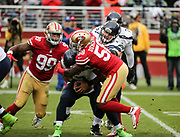 Nov 26, 2017; Santa Clara, CA, USA; Seattle Seahawks quarterback Russell Wilson (3) appears to be sacked by San Francisco 49ers defensive end Elvis Dumervil (58) but escapes at Levi's Stadium.  Seattle beat San Francisco 24-13.
