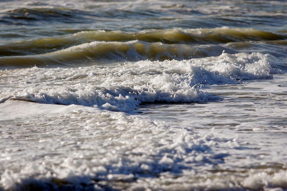 Waves crash along the beach.