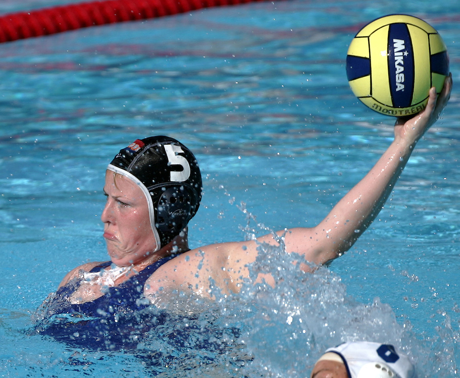 The Netherlands' Marieke van den Ham shoots and scores against Greece during their preliminary round women's water polo competition against Italy at the FINA World Championships in Montreal, Quebec Saturday 24 July 2005. Greece defeated the Netherlands 7-4.