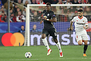 Manchester United Midfielder Paul Pogba battles with Sevilla midfielder Ever Banega (10) during the Champions League match between Sevilla and Manchester United at the Ramon Sanchez Pizjuan Stadium, Seville, Spain on 21 February 2018. Picture by Phil Duncan.
