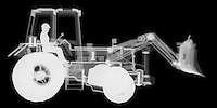 X-ray image of a utility tractor (white on black) by Jim Wehtje, specialist in x-ray art and design images.