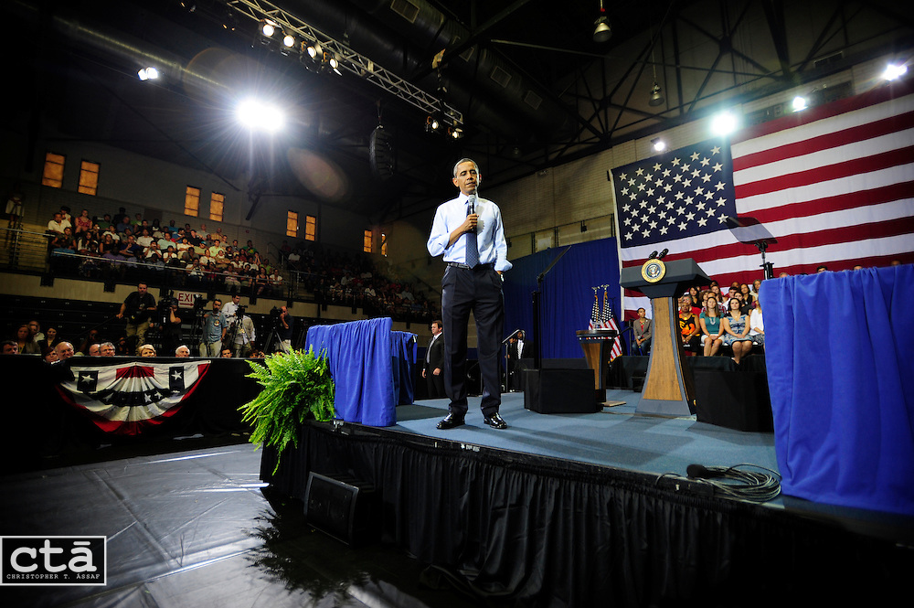 President Barack Obama pauses as he listens to a question during a Town Hall in Ritchie Coliseum at the University of Maryland. Obama was making the rounds pushing for passage of the Affordable Care Act.