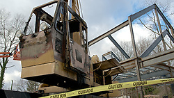 The operating cabin of a construction crane is rendered useless by fire. The crane is parked on the construction site of the future new Quaker meetinghouse in Chestnut Hill. (Bas Slabbers/for NewsWorks)<br /> <br /> http://www.newsworks.org/index.php/ma-ch/item/48808-arson-story