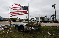 August 27, 2017 - Port Aransas, Texas, U.S. - A tattered U.S. flag blows in the wind in the aftermath of Hurricane Harvey in Port Aransas. (Credit Image: © Kin Man Hui/San Antonio Express-News via ZUMA Wire)