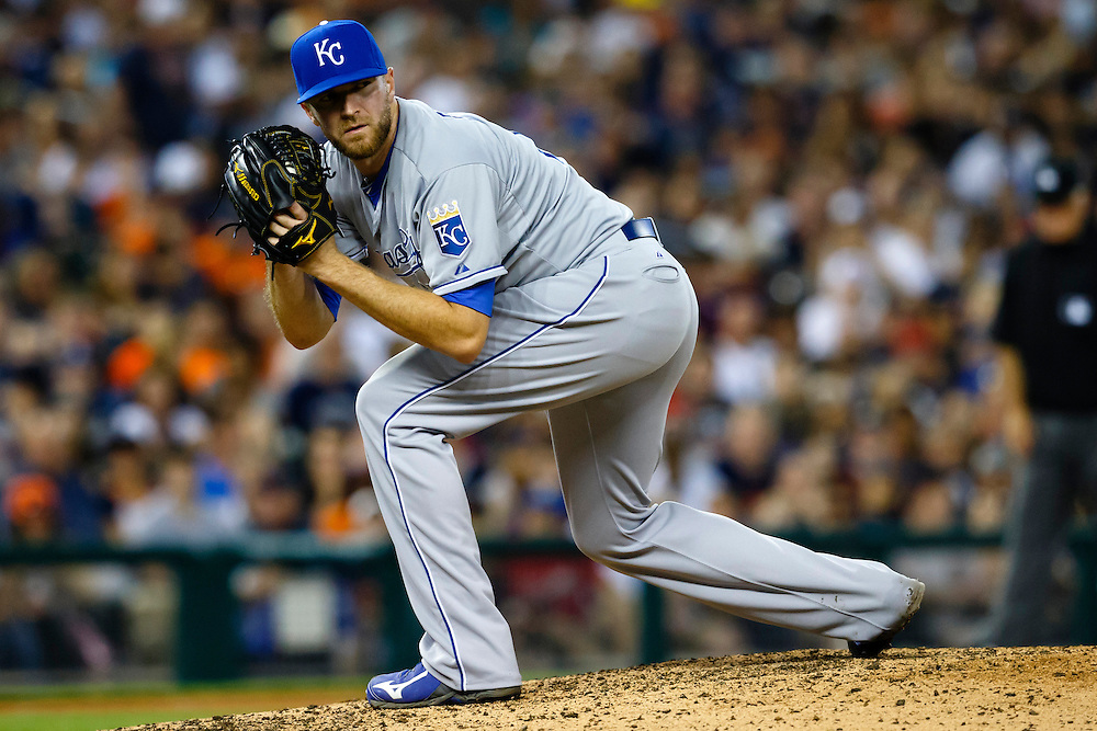 May 8, 2015; Detroit, MI, USA; Kansas City Royals relief pitcher Wade Davis (17) checks the runner on first during the eighth inning against the Detroit Tigers at Comerica Park. Detroit won 6-5. Mandatory Credit: Rick Osentoski-USA TODAY Sports