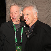 March 1, 2014, Indian Wells, California: <br /> John McEnroe poses for a photograph with Raymond Moore, CEO of the Indian Wells Tennis Garden and BNP Paribas Open, during an unveiling of a mural of McEnroe during the McEnroe Challenge for Charity presented by Esurance at Indian Wells Tennis Garden. <br /> (Photo by Billie Weiss/BNP Paribas Open)