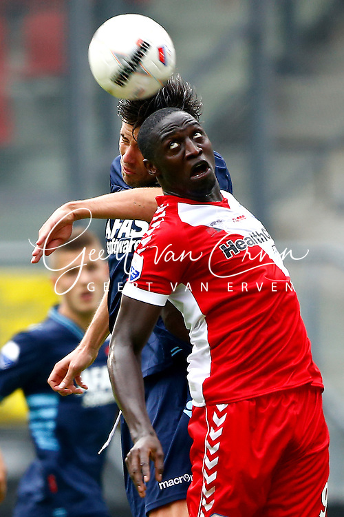 Onderwerp/Subject: FC Utrecht - AZ Alkmaar - Eredivisie<br /> Reklame:  <br /> Club/Team/Country: <br /> Seizoen/Season: 2013/2014<br /> FOTO/PHOTO: Jacob MULENGA (R) of FC Utrecht in duel with Jan WUYTENS (L) of AZ Alkmaar. (Photo by PICS UNITED)<br /> <br /> Trefwoorden/Keywords: <br /> #04 $94 &plusmn;1371811811150<br /> Photo- &amp; Copyrights &copy; PICS UNITED <br /> P.O. Box 7164 - 5605 BE  EINDHOVEN (THE NETHERLANDS) <br /> Phone +31 (0)40 296 28 00 <br /> Fax +31 (0) 40 248 47 43 <br /> http://www.pics-united.com <br /> e-mail : sales@pics-united.com (If you would like to raise any issues regarding any aspects of products / service of PICS UNITED) or <br /> e-mail : sales@pics-united.com   <br /> <br /> ATTENTIE: <br /> Publicatie ook bij aanbieding door derden is slechts toegestaan na verkregen toestemming van Pics United. <br /> VOLLEDIGE NAAMSVERMELDING IS VERPLICHT! (&copy; PICS UNITED/Naam Fotograaf, zie veld 4 van de bestandsinfo 'credits') <br /> ATTENTION:  <br /> &copy; Pics United. Reproduction/publication of this photo by any parties is only permitted after authorisation is sought and obtained from  PICS UNITED- THE NETHERLANDS