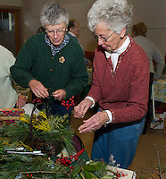 Opechee Garden Club members prepare centerpieces at the Weirs Community Center for their weekend Greens Sale and Boutique held at the Belknap Mill. Karen Bobotas/for the Laconia Daily Sun