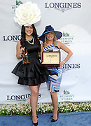 Amy Figueroa, right, of Longines, presents Ashley Lauren Kerr, of Maine, with a Longines DolceVita timepiece after Kerr wins the Longines Most Elegant Woman fashion contest, Saturday, June 11, 2016, at Belmont Park in Elmont, NY. Longines, the Swiss watchmaker known for its elegant timepieces, is the Official Watch and Timekeeper of the 148th running of the Belmont Stakes. (Diane Bondareff/AP Images for Longines)