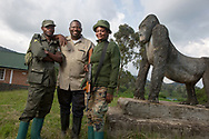 CLIENT: WILD EARTH ALLIES<br /> <br /> Kahuzi-Biega National Park rangers Safari Jules, left, and Naomie Divine Kashalulo, right, stand with Dr. Augustin Basabose, founder and executive director of Primate Expertise (PEx), at the entrance to  the park in South Kivu, D.R. Congo.