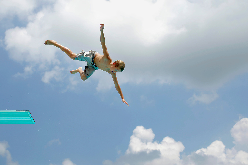 Clayton Burgener, 12, jumps off the high dive at the Monticello Family Aquatic Center Friday, July 9, 2010, in Monticello, Ill. The newly renovated facility opened for the season last weekend. (Herald & Review/ Stephen Haas)