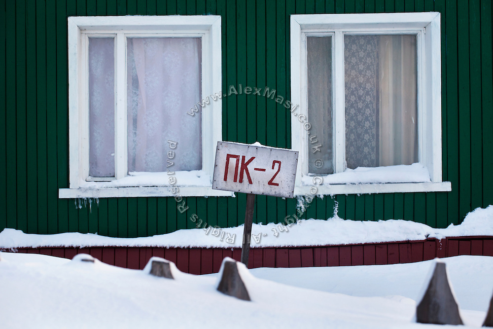 A wooden house stands in the Russian coal mining community of Barentsburg, in the Norwegian Arctic archipelago of Svalbard.