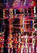 City lights reflecting on wet paving stones, Trafalgar Square, London, United Kingdom.