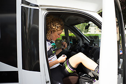 Floortje Mackaaij (NED) of Liv-Plantur Cycling Team checks the team radio before the Aviva Women's Tour 2016 - Stage 5. A 113.2 km road race from Northampton to Kettering, UK on June 19th 2016.