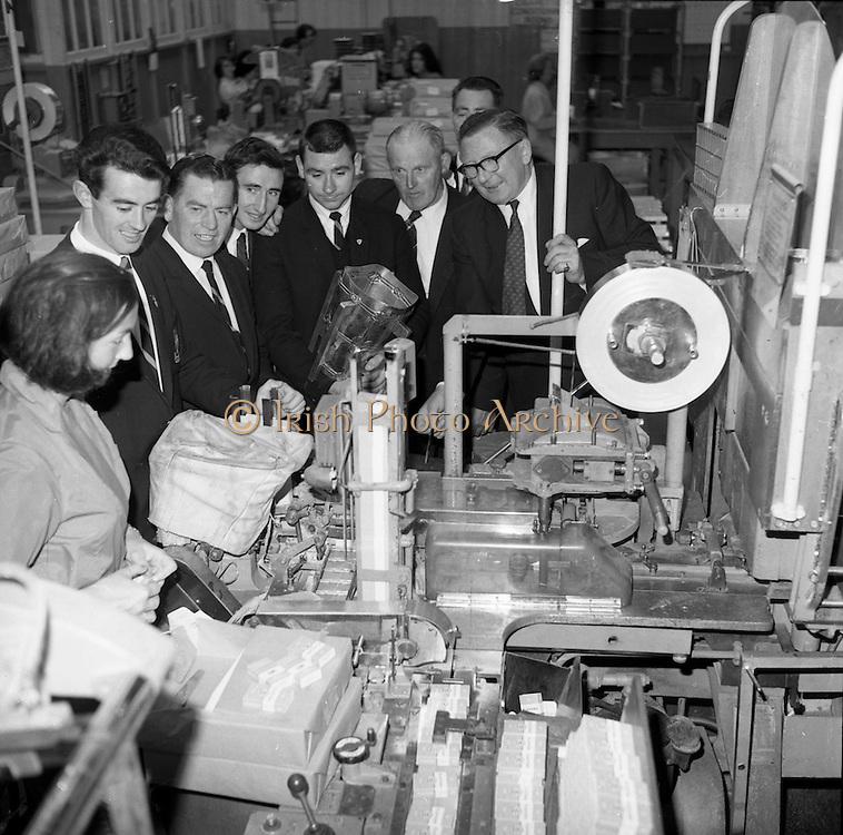 06/09/1965<br /> 09/06/1965<br /> 6 September 1965<br /> Members of the victorious Tipperary team, who won the All-Ireland Hurling final on the fifth of September 1965, visit Player's cigarette factory.<br /> From left to right: Sean O'Donoghue, Tommy Barrett, Ted Gaynor, Jimmy Doyle (Captain), Martin Kennedy, Jerry Doyle (Trainor), and M.G. Murray (Deputy Factory Manager).