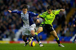 BIRMINGHAM, ENGLAND - Tuesday, December 4, 2007: Chelsea's Joe Cole and Birmingham City's Frank Queudrue during the Premiership match at St Andrews. (Photo by David Rawcliffe/Propaganda)