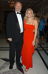 CHRIS & JANICE WRIGHT at the annual Ascot charity auction dinner this year in aid of The Princes Trust held at the Hyatt Churchill Hotel, Portman Square, London on 21st September 2004.<br />