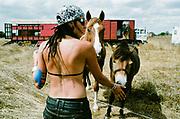 Woman with dreadlocks feeding horse, BulgariaTek, Bulgaria, August 2011